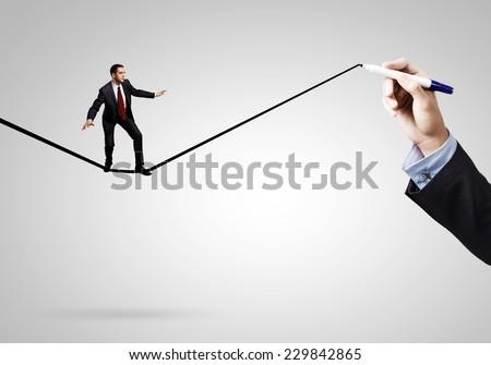 Businessman walking on drawn line. Risk concept - stock photo