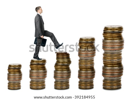 Businessman walking on gold coins