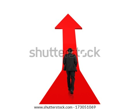 Businessman walking on growing red arrow isolated in white background