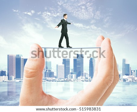 Businessman walking on line held by huge hand on modern city background. Balancing concept