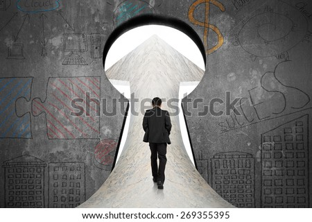 Businessman walking on marble road toward keyhole door with business concept doodles concrete wall background - stock photo