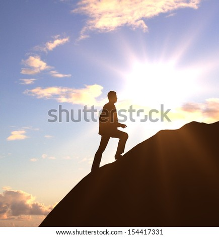 businessman walking on rock and sunrise