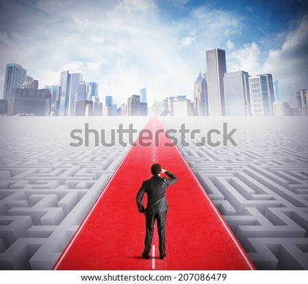Businessman walking on the road to success - stock photo