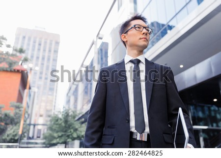 Businessman walking outdoors in city business district