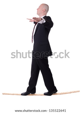 businessman walking the line isolated on white background - stock photo