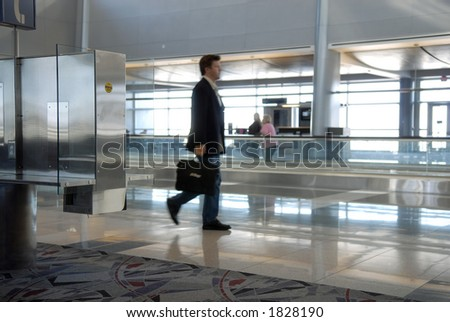 businessman walking through airport