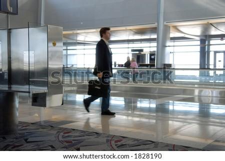 businessman walking through airport - stock photo