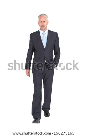 Businessman walking to camera on white background - stock photo