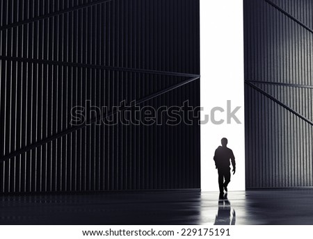 businessman walking to open gate - stock photo
