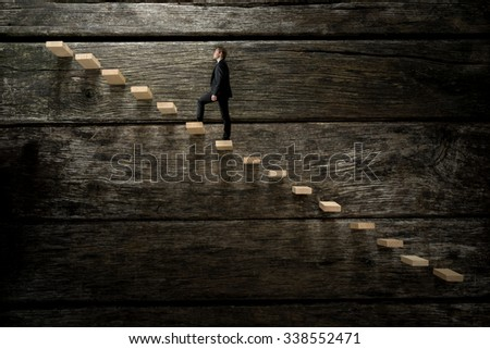 Businessman walking up on wooden stairway, conceptual of development business career. - stock photo