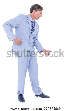 Businessman walking while gesturing with hands on a white background