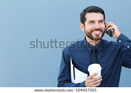 Businessman walking with coffee and folder with documents on the phone
