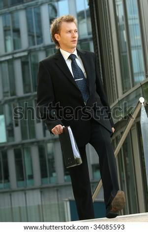 businessman walking with folder - stock photo