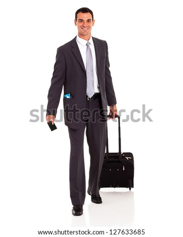 businessman walking with trolley bag and passport - stock photo