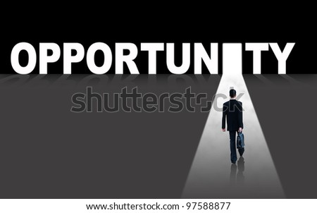 Businessman walks toward an opportunity door