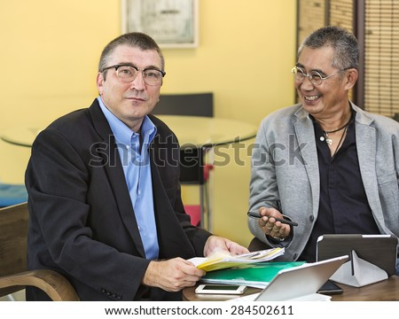 businessman was introduced and looking camera - stock photo