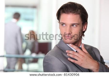 Businessman watching - stock photo