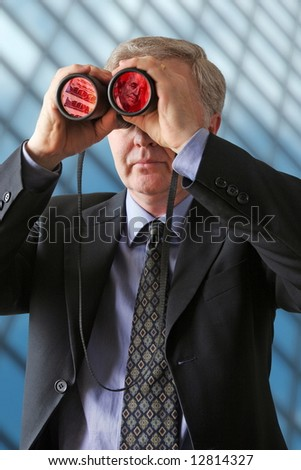 Businessman watching for new ways to develop profits - stock photo