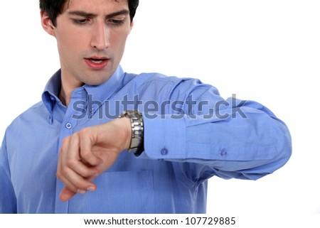 businessman watching his watch - stock photo