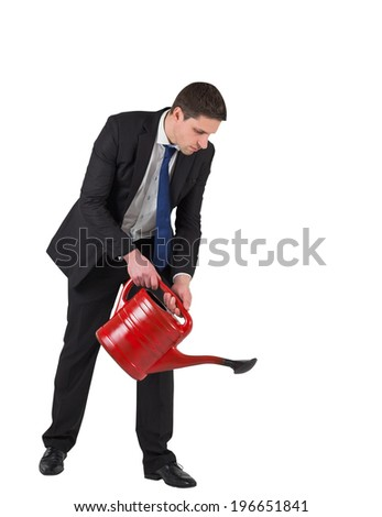Businessman watering with red can on white background
