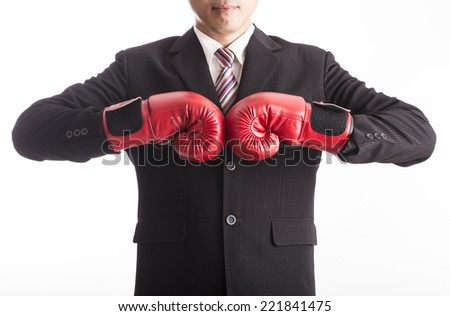 Businessman wear red boxing gloves with white background