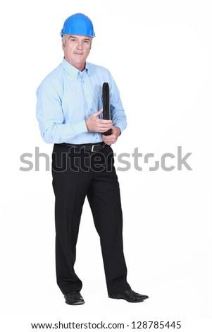 Businessman wearing a hardhat - stock photo