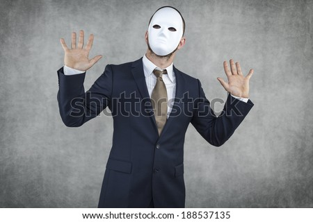 businessman wearing a mask - stock photo