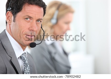 Businessman wearing a telephone headset - stock photo