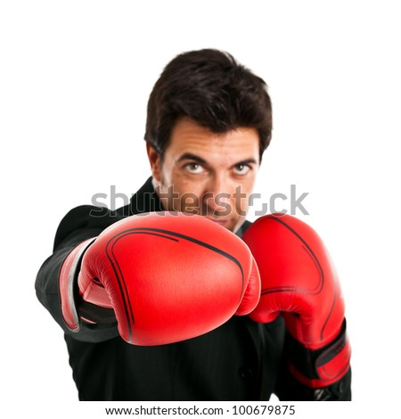 Businessman wearing boxing gloves isolated on white - stock photo