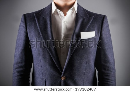 Businessman wearing formal business suit. business card in the pocket - stock photo