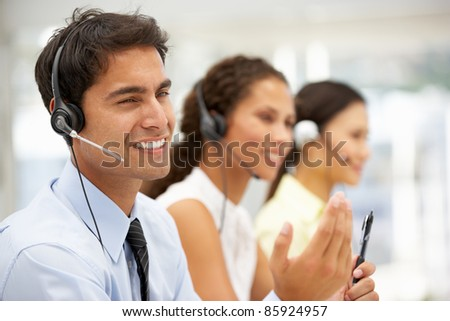 Businessman wearing headset - stock photo