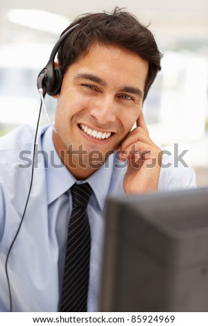 Businessman wearing headset - stock photo