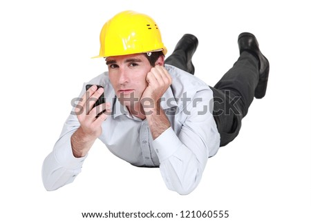 businessman wearing helmet talking on his cell