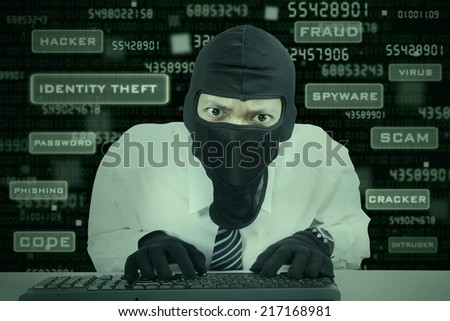 Businessman wearing mask stealing information in office - stock photo