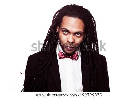 businessman wearing suit and bow jamaican man smiling - stock photo