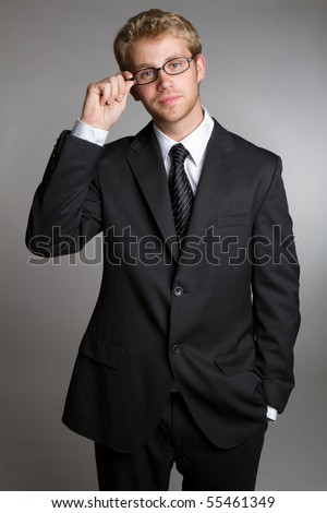 Businessman wearing suit and glasses - stock photo