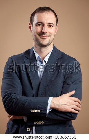 Businessman wearing suit in a relaxed position. - stock photo