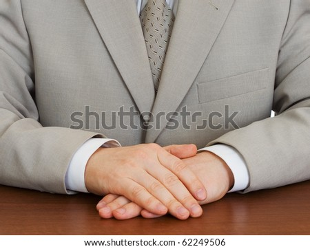 Businessman wearing suit with hands clasped isolated