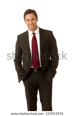 Businessman wearing suite holding a message card isolated on white - stock photo