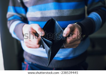 Businessman well-dressed with empty wallet - stock photo