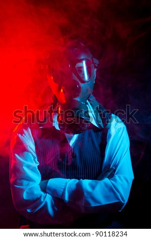 Businessman whit a gas mask over smoky background - stock photo