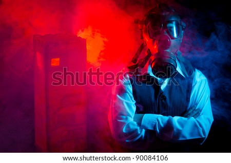 Businessman whit a gasmask over smoky background - stock photo
