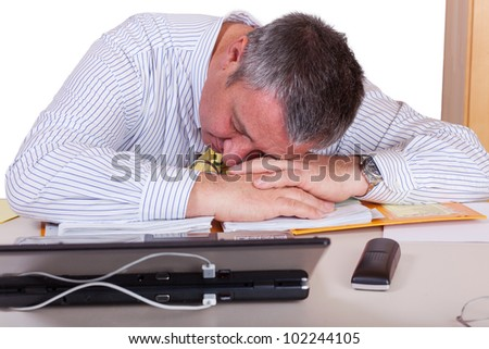 Businessman who has fallen asleep at your desk - stock photo