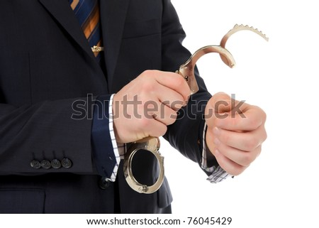 Businessman who put handcuffs on hands . Studio shot. White background - stock photo