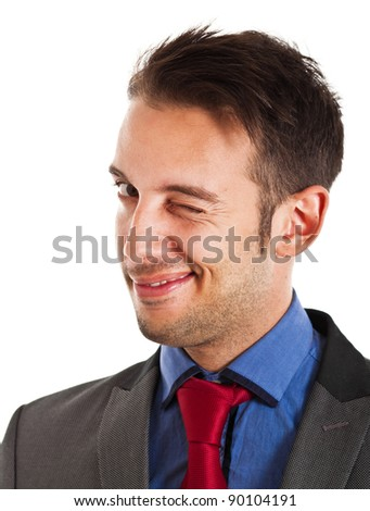 Businessman winking at you - stock photo