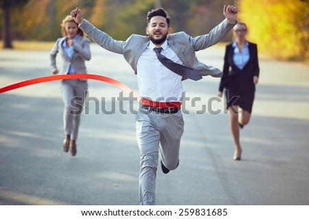 Businessman winning marathon - stock photo