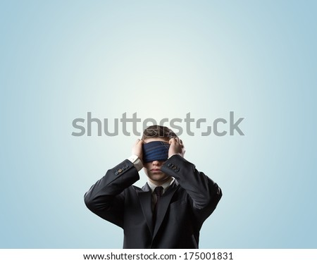 businessman with a bandage on his eyes - stock photo
