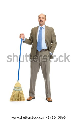 Businessman with a broom on a white background