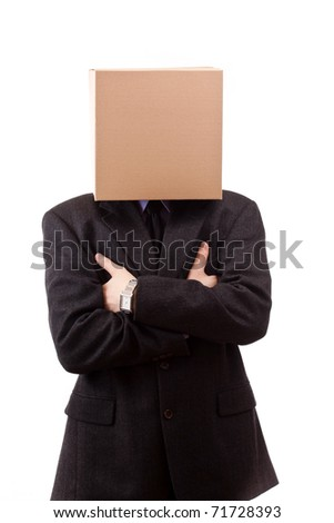 Businessman with a brown box on his head - stock photo