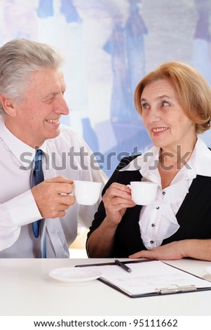 businessman with a business woman on a white background
